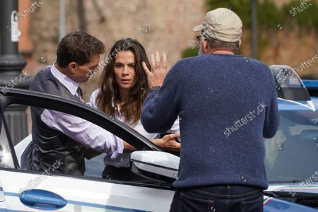 Director Christopher McQuarrie, back to camera, speaks to actors Tom Cruise, left, and Hayley Atwell during the shooting of the film Mission Impossible 7, in Rome