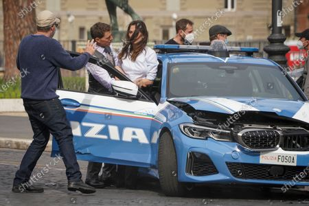 Director Christopher McQuarrie, left, speaks to actors Tom Cruise, center, and Hayley Atwell during the shooting of the film Mission Impossible 7, in Rome