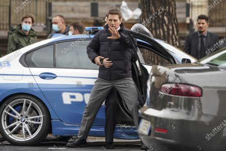 Actors Tom Cruise and Hayley Atwell, behind, perform during the shooting of the film Mission Impossible 7, directed by Christopher McQuarrie, in Rome