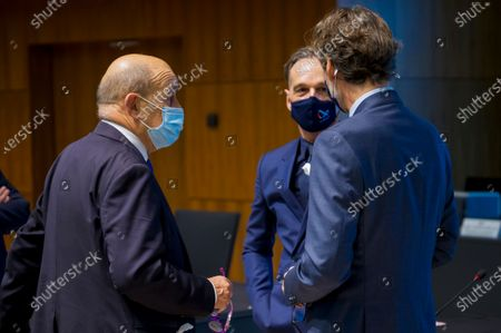 Stock Photo of Federal minister for Foreign Affairs of Germany Heiko Mass (C) and Minister for Europe and foreign affairs of France Jean-Yves Le Drian (L) speak prior to EU Foreign Affairs council in Luxembourg, 12 October 2020.