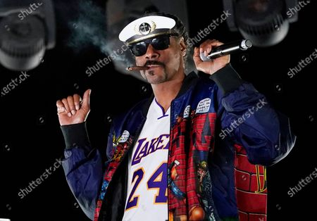 """Snoop Dogg performs a DJ set as """"DJ Snoopadelic"""" during the """"Concerts In Your Car"""" series, in Ventura, Calif. The rapper turns 49 on Oct. 20"""