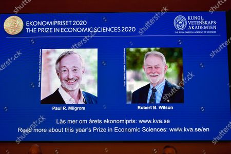 US economists Paul R. Milgrom (L) and Robert B. Wilson (R) receive the Sveriges Riksbank Prize in Economic Sciences in Memory of Alfred Nobel for 2020 presented at a press conference in Stockholm, Sweden, 12 October 2020. Americans Paul Milgrom and Robert Wilson receive the 2020 Nobel Prize in Economic Science for improving auction theory.