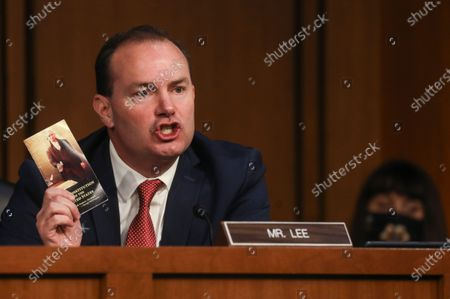 U.S. Senator Mike Lee (R-UT), who recently tested positive for coronavirus disease (COVID-19), holds a pocket copy of the U.S. Constitution as he speaks during a Senate Judiciary Committee con during the Senate Judiciary Committee confirmation hearing for Supreme Court nominee Judge Amy Coney Barrett on Capitol Hill in Washington, DC, USA, 12 October 2020. Barrett was nominated by US President Donald J. Trump to fill the vacancy left by Justice Ruth Bader Ginsburg who passed away on 18 September 2020.