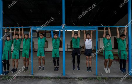 Nepalese youths participate in a physical training session amid coronavirus pandemic at the Gurkha AXN training institute in Kathmandu, Nepal, 12 October 2020. The British Army will recruit 340 Nepalese youths from the 540 finalist youths under age of 18 years which has selected from all over the Nepal. Those selected will join the elite regiment of Brigade of Gurkhas under the British Army. The British Gurkha soldier recruitment selection process will take place in January 2021 at British Gurkha camp situated in Pokhara City, Nepal.