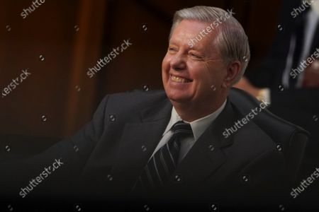United States Senator Lindsey Graham (Republican of South Carolina), Chairman, US Senate Judiciary Committee, smiles during a confirmation hearing in Washington, D.C., U.S.,. Voters will get their first close look at Judge Amy Coney Barrett in hearings that begin today and are all but certain to lead to President Donald Trump's Supreme Court nominee being placed on the high court just days before the election. Photographer: Stefani Reynolds/Bloomberg