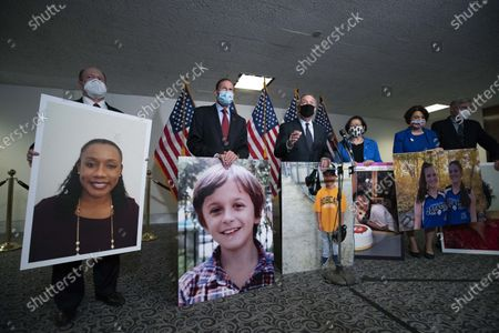 From left, Sen. Chris Coons, D-Del., Sen. Richard Blumenthal, D-Conn., Sen. Dick Durbin, D-Ill., Sen. Mazie Hirono, D-Hawaii, Sen. Amy Klobuchar, D-Minn., and Sen. Sheldon Whitehouse, D-R.I., hold photographs of people who where saved due the Affordable Care Act (ACA) during a news conference, after the confirmation hearing of President Donald Trump's Supreme Court nominee Amy Coney Barrett, in Washington