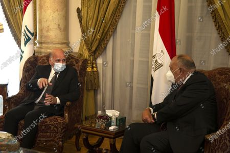 Egyptian Foreign Minister Sameh Shoukry (R) meets with his Iraqi Foreign Minister Fuad Hussein (L) at Tahrir palace, in Cairo, Egypt, 12 October 2020. Hussein is visiting Egypt ahead of a trilateral meeting between foreign ministers of Egypt, Iraq and Jordan scheduled in Cairo on 13 October.