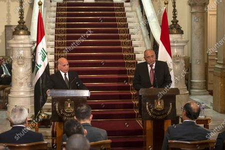 Egyptian Foreign Minister Sameh Shoukry (R) and his Iraqi counterpart Fuad Hussein (L) give a joint press conference at Tahrir palace, in Cairo, Egypt, 12 October 2020. Hussein is visiting Egypt ahead of a trilateral meeting between foreign ministers of Egypt, Iraq and Jordan scheduled in Cairo on 13 October.