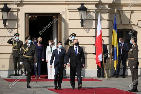 Polish President Andrzej Duda (C) with his wife Agata Kornhauser-Duda (3L) and President of Ukraine Volodymyr Zelenski (C-L) with wife Olena Zelenska (4L) during the official welcome iin front of the Mariyinsky Palace in Kiev, Ukraine 12 October 2020. President Duda and his wife are on an official visit to Ukraine.