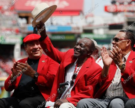 Stock Photo of Former Cincinnati Reds player Joe Morgan waves to the crowd as he attends a statue dedication ceremony for teammate Pete Rose before a baseball game between the Cincinnati Reds and the Los Angeles Dodgers, in Cincinnati