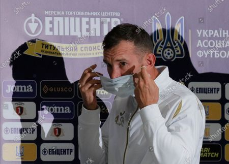 Ukrainian national soccer team head coach Andriy Shevchenko puts on a protective mask as he leaves a press conference in Kiev, Ukraine, 12 October 2020. Ukraine will face Spain in their UEFA Nations League group stage, league A, group 4 soccer match in Kiev, Ukraine on 13 October 2020.
