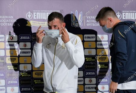 Ukrainian national soccer team head coach Andriy Shevchenko puts on a protective mask as he and his player Serhiy Sydorchuk leave a  press conference in Kiev, Ukraine, 12 October 2020. Ukraine will face Spain in their UEFA Nations League group stage, league A, group 4 soccer match in Kiev, Ukraine on 13 October 2020.