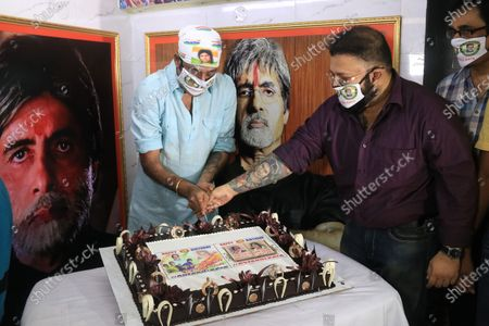 Stock Image of Member of All Bengal Amitabh Bachchan Fan association slicing cake to celebrate the Indian Actor Amitabh Bachchan 78th  birthday in Kolkata.