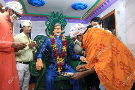 Members of All Bengal Amitabh Bachchan Fan association offer prayer in front of Indian Bollywood actor Amitabh Bachchan idol to celebrate his 78th  birthday in Kolkata.