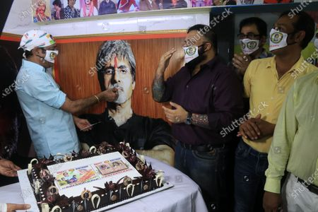 Member of All Bengal Amitabh Bachchan Fan association slicing cake to celebrate the Indian Actor Amitabh Bachchan 78th  birthday in Kolkata.