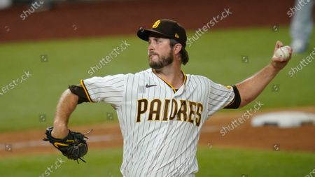 San Diego Padres' Drew Pomeranz pitches in Game 3 of a baseball National League Division Series against the Los Angeles Dodgers, in Arlington, Texas