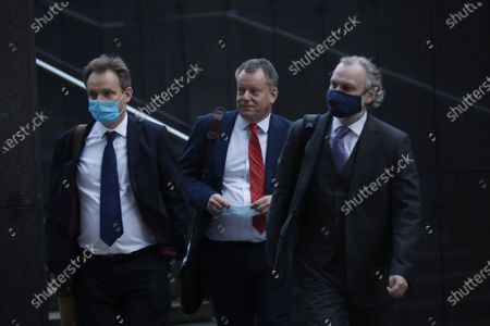 British Brexit negotiator David Frost, center, and Britain's Ambassador to the European Union Tim Barrow, right, arrive for a meeting with European Commission's Head of Task Force for Relations with the United Kingdom Michel Barnier at EU headquarters in Brussels