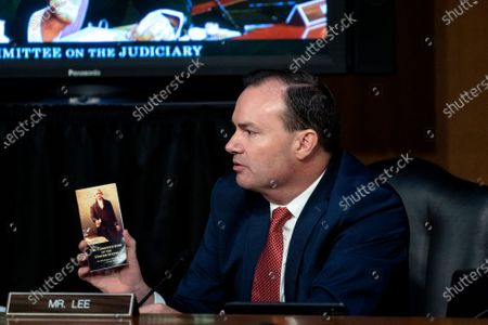 Senator Mike Lee, a Republican from Utah, holds a copy of the United States Constitution as he speaks during a Senate Judiciary Committee confirmation hearing  in Washington, DC, USA, 12 October 2020. Barrett was nominated by US President Donald J. Trump to fill the vacancy left by Justice Ruth Bader Ginsburg who passed away on 18 September 2020.