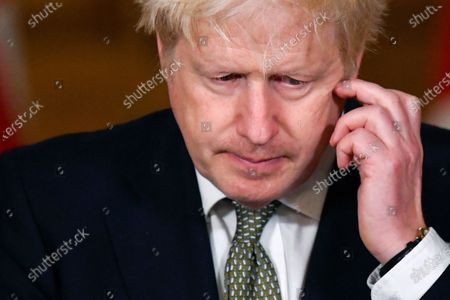 Britain's Prime Minister Boris Johnson gestures, during a coronavirus briefing in Downing Street, London