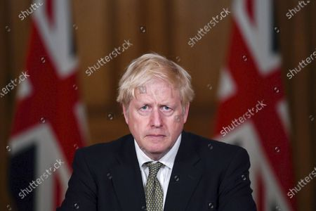 Britain's Prime Minister Boris Johnson listens during a coronavirus briefing in Downing Street, London