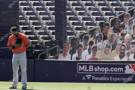 Houston Astros Michael Brantley observes a moment of silence for Hall of Famer second baseman Joe Morgan before Game 2 of a baseball American League Championship Series against the Tampa Bay Rays, in San Diego. Morgan passed away on Sunday, Oct. 11th