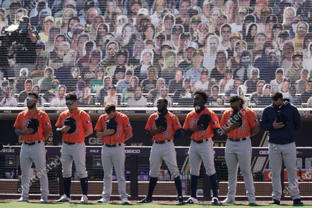 Houston Astros observe a moment of silence for Hall of Famer second baseman Joe Morgan before Game 2 of a baseball American League Championship Series against the Tampa Bay Rays, in San Diego. Morgan passed away on Sunday, Oct. 11th