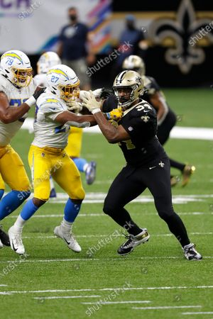 Los Angeles Chargers running back Joshua Kelley (27) and New Orleans Saints defensive end Cameron Jordan (94) during an NFL football game, in New Orleans