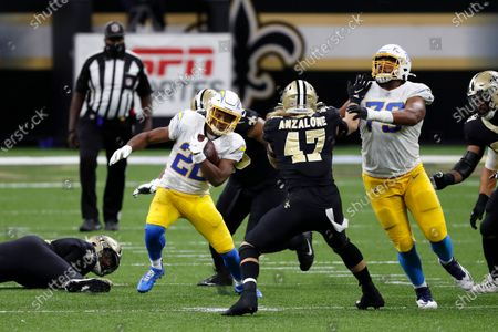 Los Angeles Chargers running back Justin Jackson (22) runs the ball during an NFL football game against the New Orleans Saints, in New Orleans
