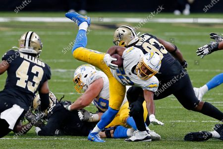 Los Angeles Chargers running back Justin Jackson (22) carries against New Orleans Saints defensive tackle David Onyemata (93) and free safety Marcus Williams (43) in the second half of an NFL football game in New Orleans