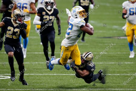 Los Angeles Chargers running back Justin Jackson (22) carries against New Orleans Saints free safety Marcus Williams (43) in the first half of an NFL football game in New Orleans