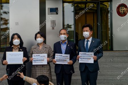 """Stock Image of (from left) Members parliament of the Democratic Party, Yoon Mi-hyang, Lee Soo-jin, Yoon Joon-byeong, and Lee Kyu-min hold a press conference in front of the German Embassy before delivering a letter from Korean lawmakers who want to protect the """"Statue of Peace"""" in the German capital, Mitte, Berlin"""