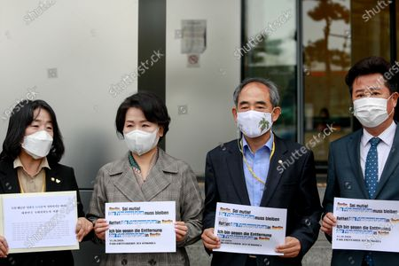 """Stock Picture of (from left) Members parliament of the Democratic Party, Yoon Mi-hyang, Lee Soo-jin, Yoon Joon-byeong, and Lee Kyu-min hold a press conference in front of the German Embassy before delivering a letter from Korean lawmakers who want to protect the """"Statue of Peace"""" in the German capital, Mitte, Berlin"""