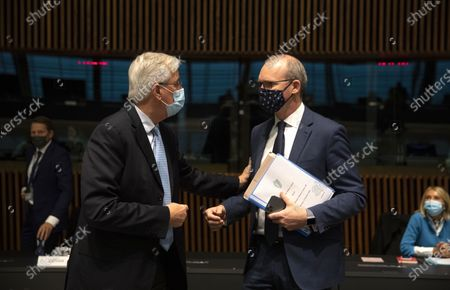 Stock Photo of European Commission's Head of Task Force for Relations with the United Kingdom Michel Barnier, left, speaks with Ireland's Foreign Minister Simon Coveney during a meeting of EU General Affairs ministers at the European Council building in Luxembourg, . European Commission's Head of Task Force for Relations with the United Kingdom Michel Barnier will brief ministers on the state of play in EU-UK Brexit negotiations ahead of a key EU summit on Thursday