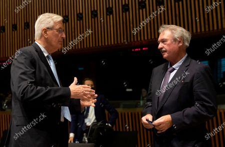 European Commission's Head of Task Force for Relations with the United Kingdom Michel Barnier (L) speaks with Luxembourg's Foreign Minister Jean Asselborn during a meeting of EU General Affairs ministers at the European Council building in Luxembourg, 13 October 2020. European Commission's Head of Task Force for Relations with the United Kingdom Michel Barnier will brief ministers on the state of play in EU-UK Brexit negotiations ahead of a key EU summit on 15 October 2020.