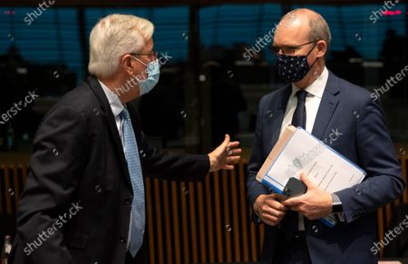 European Commission's Head of Task Force for Relations with the United Kingdom Michel Barnier (L) speaks with Ireland's Foreign Minister Simon Coveney during a meeting of EU General Affairs ministers at the European Council building in Luxembourg, 13 October 2020. European Commission's Head of Task Force for Relations with the United Kingdom Michel Barnier will brief ministers on the state of play in EU-UK Brexit negotiations ahead of a key EU summit on 15 October 2020.