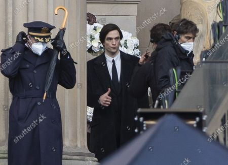 Robert Pattinson takes part in filming for the The Batman at St George's Hall, Liverpool.