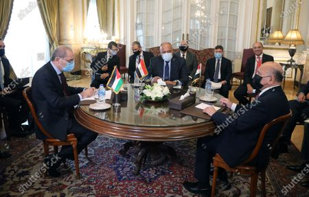 Egyptian Foreign Minister Sameh Shoukry (C) meets with his Iraqi Foreign Minister Fuad Hussein (R) and Jordan's Foreign Minister Ayman Safadi  (L) at Tahrir palace, in Cairo, Egypt, 13 October 2020. Egyptian, Iraqi and Jordanian foreign ministers met in Cairo to discuss economic cooperation and regional issues of mutual interest.