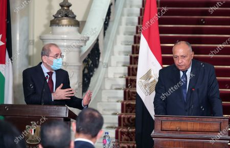 Egyptian Foreign Minister Sameh Shoukry (R) and Jordan's Foreign Minister Ayman Safadi (L) during a press conference at Tahrir palace, in Cairo, Egypt, 13 October 2020. Egyptian, Iraqi and Jordanian foreign ministers met in Cairo to discuss economic cooperation and regional issues of mutual interest.