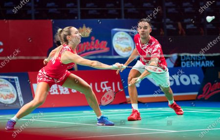 Chris Adcock (R) and Gabrielle Adcock (L) of England in action against Patrick Scheiel and Franziska Volkmann of Germany during their mixed doubles match at the Danisa Denmark Open badminton tournament in Odense, Denmark, 13 October 2020.