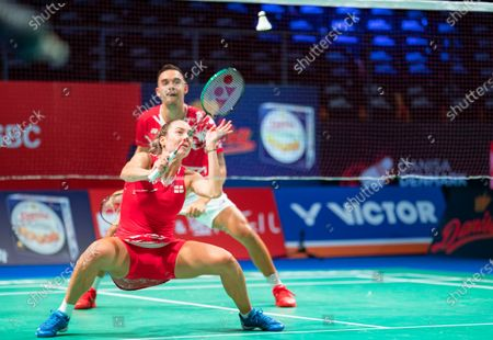 Gabrielle Adcock (front) and Chris Adcock (back) of England in action against Patrick Scheiel and Franziska Volkmann of Germany during their mixed doubles match at the Danisa Denmark Open badminton tournament in Odense, Denmark, 13 October 2020.