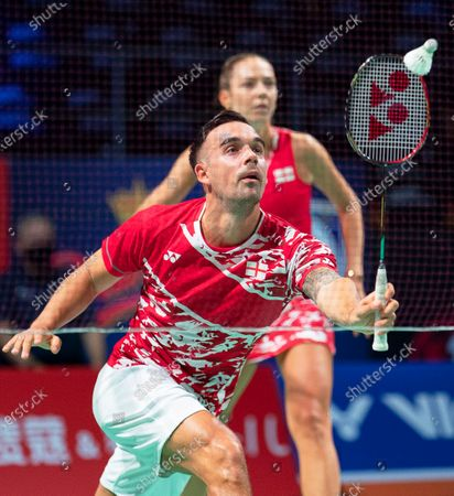 Chris Adcock (front) and Gabrielle Adcock (back) of England in action against Patrick Scheiel and Franziska Volkmann of Germany during their mixed doubles match at the Danisa Denmark Open badminton tournament in Odense, Denmark, 13 October 2020.
