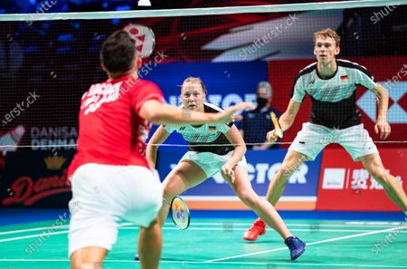 Stock Photo of Patrick Scheiel (R) and Franziska Volkmann (C) of Germany in action against Gabrielle Adcock and Chris Adcock of England during their mixed doubles match at the Danisa Denmark Open badminton tournament in Odense, Denmark, 13 October 2020.