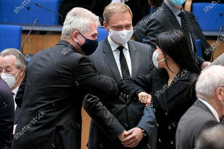 (L-R) Minister of Economics, Innovation, Digitisation and Energy of North Rhine-Westphalia state, Andreas Pinkwart, Free Democratic Party (FDP) chairman and faction chairman in the German 'Bundestag' parliament  Christian Lindner and the wife of former German chancellor Gerhard Schroeder, Schroeder-Kim So-yeon, elbow bumb prior to the state memorial ceremony to honor the deceased late State Premier Wolfgang Clement in Bonn, Germany, 13 October 2020.  Clement, former Prime Minister of North Rhine-Westphalia and Federal Minister of Economics and Labor, died in Bonn on 27 September 2020 at the age of 80.