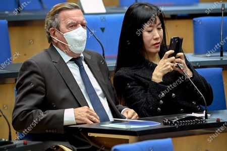 Former German chancellor Gerhard Schroeder (L) and his wife Schroeder-Kim So-yeon (R) attend the state memorial ceremony to honor the deceased late State Premier Wolfgang Clement in Bonn, Germany, 13 October 2020.  Clement, former Prime Minister of North Rhine-Westphalia and Federal Minister of Economics and Labor, died in Bonn on 27 September 2020 at the age of 80.