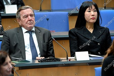 Stock Photo of Former German chancellor Gerhard Schroeder (L) and his wife Schroeder-Kim So-yeon (R) attend the state memorial ceremony to honor the deceased late State Premier Wolfgang Clement in Bonn, Germany, 13 October 2020.  Clement, former Prime Minister of North Rhine-Westphalia and Federal Minister of Economics and Labor, died in Bonn on 27 September 2020 at the age of 80.