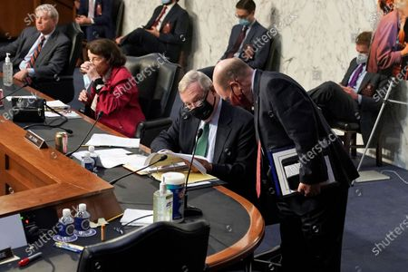 Stock Picture of Sen. Dick Durbin, D-Ill., speaks with Sen. Chris Coons, D-Del., during a confirmation hearing before the Senate Judiciary Committee, on Capitol Hill in Washington