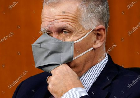 Sen. Thom Tillis, R-S.C., puts his hand under his face mask during a confirmation hearing for Supreme Court nominee Amy Coney Barrett before the Senate Judiciary Committee, on Capitol Hill in Washington