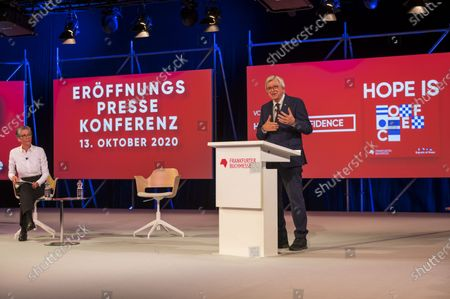 Stock Picture of Hesse's State Premier Volker Bouffier speaks at the opening conference of the 2020 Frankfurt Book Fair during the coronavirus pandemic. On left side sits Karin Schmidt-Friderichs, head of the German Book association. The Frankfurt Book Fair is the world's largest trade fair for books and is taking place this year at a smaller scale and with many events either online or scattered throughout the city of Frankfurt due to the pandemic.