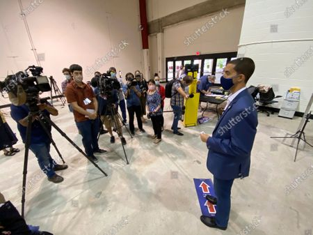 Harris County Clerk Chris Hollins explains all of the safety measures that will be in place at all voting centers from the early voting period until Election Day during a media tour of a mock-up voting location, in Houston