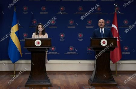 Sweden's Foreign Minister Ann Linde, left, and Turkish Foreign Minister Mevlut Cavusoglu speak to the media after their talks, in Ankara, Turkey, . Linde on Tuesday subtly criticized Turkey over its curbs on freedom of expression, after Cavusoglu took a swipe at Stockholm's policies during a joint news conference that quickly turned tense